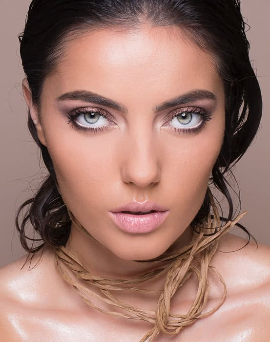brunette woman with beautiful skin and flawless makeup
